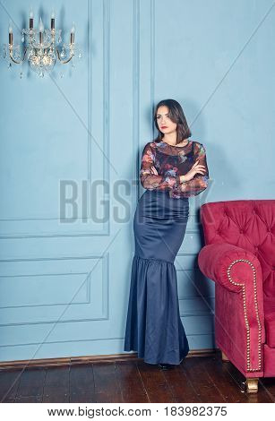the beautiful young woman the brunette to the utmost in a classical interior blue plaster