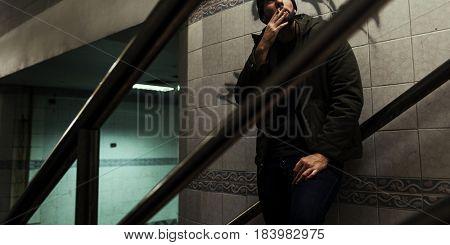 Suffering failure man smoking alone