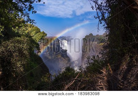 View of the Victoria Falls with rainbow in Zimbabwe Africa