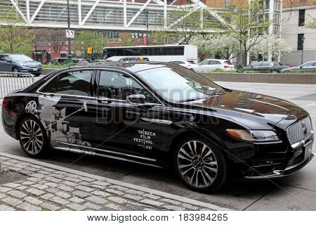 NEW YORK, NY - APRIL 26: Lincoln Continental with Tribeca Film Festival motive parking outside at BMCC Tribeca PAC on April 26, 2017 in New York City