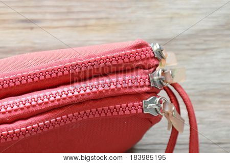 red fabric purse on the wooden board