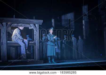 MOSCOW - JAN 25, 2017: Prisoners and female turnkey on stage at Passenger performance in Moscow Theater New Opera