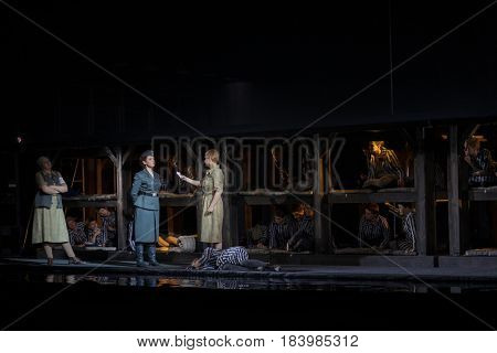 MOSCOW - JAN 25, 2017: Prisoners and turnkey on stage at Passenger performance in Moscow Theater New Opera