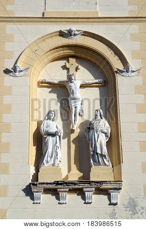 DUBRANEC, CROATIA - NOVEMBER 17: Crucifixion, Virgin Mary and Saint John under the cross, Parish Church of Our Lady of Snow in Dubranec, Croatia on November 17, 2010.