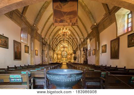 CARMEL-BY-THE-SEA, CALIFORNIA - April 27: The Basilica of Mission San Carlos Borromeo Del Rio Carmelo (Commonly Known As Carmel Mission) April 27, 2017 in Carmel-By-The-Sea.