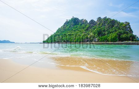 Beautiful Caribbean sea and green palm trees. Summer sea landscape as a background.White sand beach and Caribbean sea
