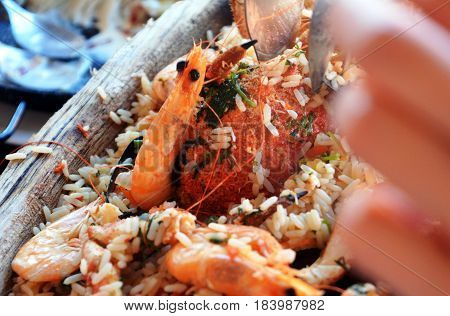 A huge platter of seafood and rice. Very tasty food on a light background.