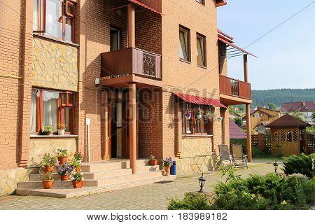 Modern cottage with porch and veranda. Carpathians Ukraine