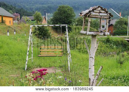 Wooden swing and birdhouse in Carpathians Ukraine