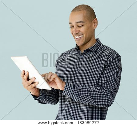 A guy is smiling using tablet