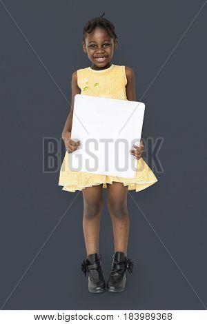 African little girl holding blank placard studio portrait