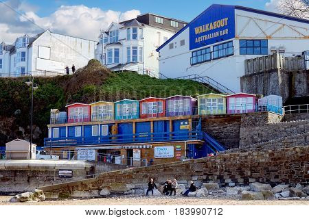 Newquay, Cornwall, Uk - April 1 2017: Colourful Beach Huts Above Newquay Beach, In Front Of The Walk