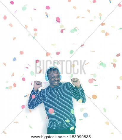 African man dancing with headphones enjoy the music