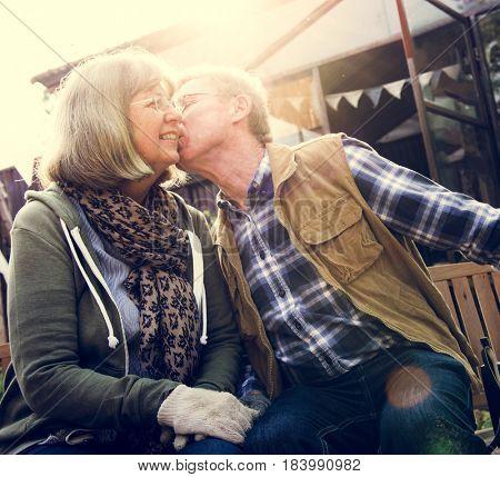 Senior Couple Man Giving Woman a Cheek Kiss