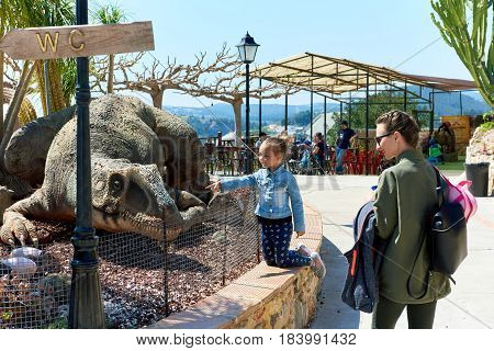 Algar Spain - April 8 2017: People in the Dino Park of Algar. It is a unique entertainment and educational park. Spain
