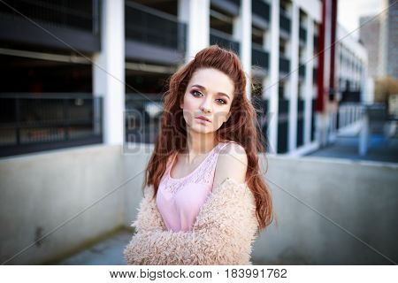 Portrait of wonderful young Redhead woman with long hair looking at camera.