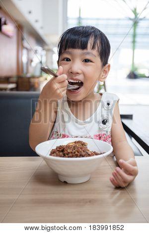 Asian Little Chinese Girl Eating Braised Pork Rice