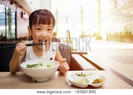 Asian Little Chinese Girl Eating Beef Noodles Soup