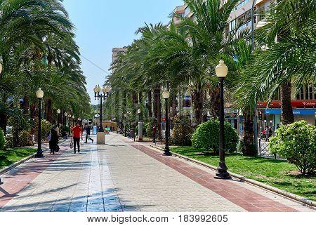 Alicante Spain- People walking along the Avenue Federico Soto in Alicante. Costa Blanca. Spain