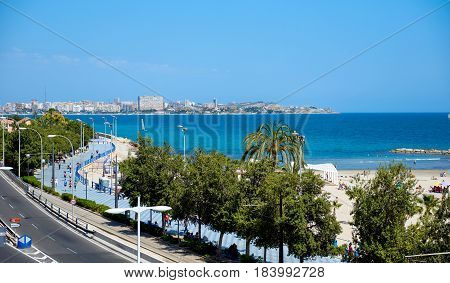 Alicante Spain - April 17 2017: Postiguet Beach and the highway of Alicante city. Alicante is a main resort city on the Costa Blanca. Spain