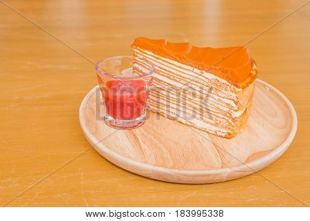 Chiffon Cake on the wood plate in the wood floor