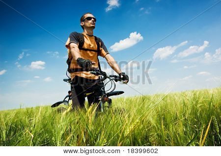 biker in summer field