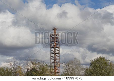 Industrial tower and equipment telecom network set on a cloudy sky panorama composition