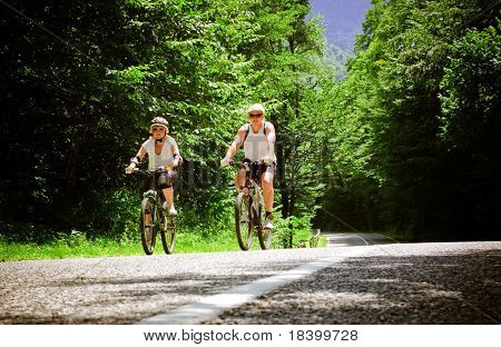 two bikers at forest road