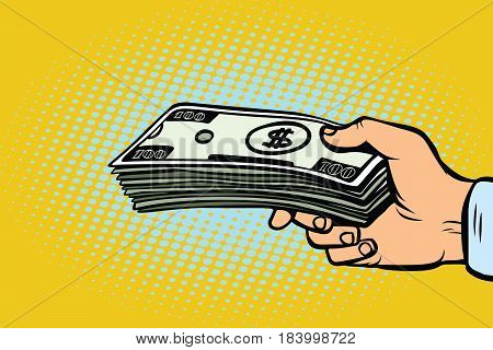 Stack of dollars in hand, a bribe. Pop art retro vector illustration