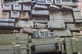 Stacks of old military ammunition boxes in specific ukrainian restaurant poster