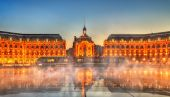Iconic view of Place de la Bourse with tram and water mirror fountain in Bordeaux - France, Gironde poster