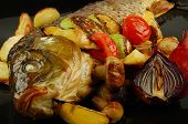 Baked fish with vegetables mushrooms and lemon. Selective focus. poster
