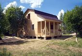 Suburban house construction with OSB panels on sunny summer day side view poster