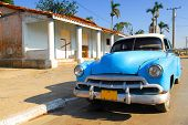 Vintage blue oldtimer car in the streets of Vinales, Cuba poster