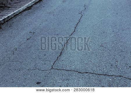 Abstract cracked background as basis for any creative design. Cement, asphalt floor fissure pattern. Crack texture. Cracked wall texture broken plate, abstract lines pattern distressed background poster