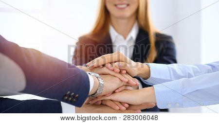 Business Team Showing Unity With Their Hands Together. Group Of People Joining Hands And Representin
