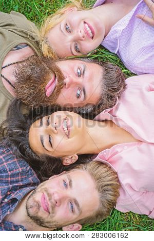 Friendship Through Whole Life. Company Friends Lay Grass Top View. Blonde Or Brutal Hipster Friends
