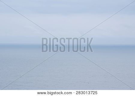 Dramatic Seascape With Grey Cloudy Sky Over It