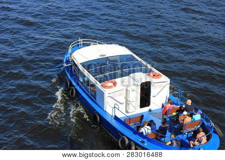 St. Petersburg, Russia - July 18, 2018: Excursion And Tour Cruise Boat On Neva River Water. Cruise S