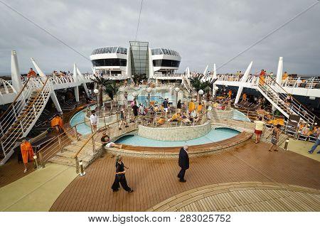 Passenger Ferry, Midsea, Spain - June 09, 2012: Passengers Enjoy At Swimming Pool On Upper Deck Of T