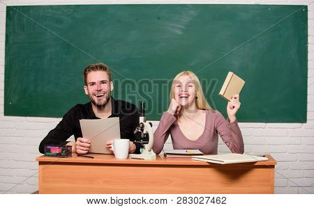 Having Fun In College. Carefree Students. Enjoying Time In College. Guy And Girl Sit Classroom. Stud