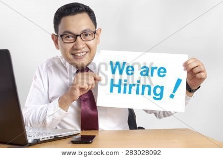 Portrait Of Happy Smiling Asian Businessman Shows We Are Hiring Announcement, Hiring Recruitment Con