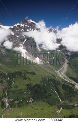 High Mountains With Clouds And Frosen Snow
