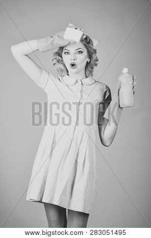 Cleaning, retro style, purity. Cleanup, cleaning services, wife, gender. Pinup woman hold soup bottle, sponge. Retro woman cleaner on pink background. Housekeeper in uniform with clean spray, sponge. poster