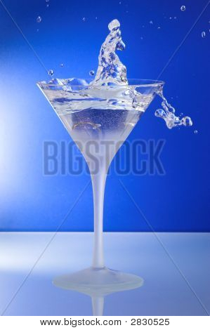 Cocktail Glass With Man Or Woman Picking The Ring Up To Hand Over