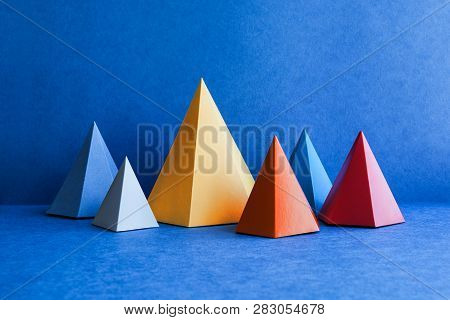 Minimal Geometric Still Life Background. Platonic Solid Geometric Figures. Three-dimensional Pyramid