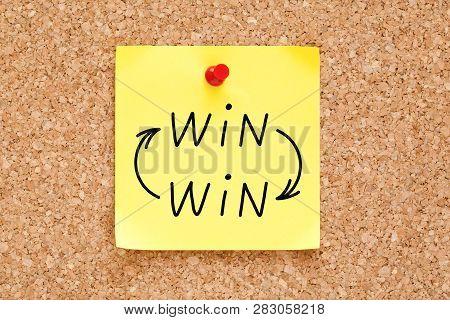 Win-win Arrows Concept Handwritten On Yellow Sticky Note Pinned On Bulletin Cork Board.
