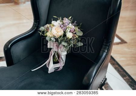 A Beautiful Elegant Bouquet For The Bride Is Lying On The Chair