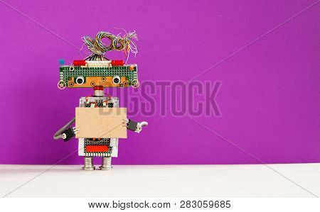 Robot With A Cardboard Card Mockup. Creative Design Robotic Toy Holding A Blank Empty Paper Poster,