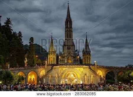 Lourdes, France; August 2013:   Pilgrims Partaking In La Procession Mariale Aux Flambeaux Or The Tor